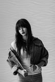 Portrait of beautiful girl dressing in 90s style fashion. Black and white portrait of beautiful young woman dressing in 90s style fashion Royalty Free Stock Photography