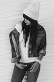 Portrait of beautiful girl dressing in 90s style fashion. Black and white portrait of beautiful young woman dressing in 90s style fashion Royalty Free Stock Photos
