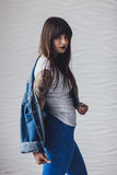 Portrait of beautiful girl dressing in 90s style fashion. Portrait of beautiful tattooed young woman dressing in 90s style fashion Royalty Free Stock Photo