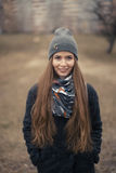 Portrait of a beautiful girl in early spring in a gray cap Royalty Free Stock Images