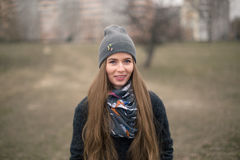 Portrait of a beautiful girl in early spring in a gray cap Stock Photography