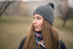 Portrait of a beautiful girl in early spring in a gray cap Royalty Free Stock Image