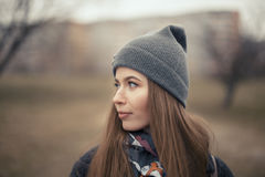 Portrait of a beautiful girl in early spring in a gray cap Royalty Free Stock Photography