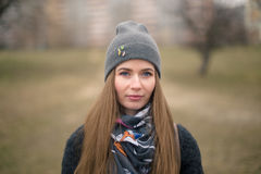 Portrait of a beautiful girl in early spring in a gray cap Stock Images