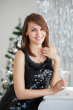 Portrait of a beautiful girl in elegant Christmas decorations Stock Photo