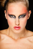 Portrait of beautiful girl with extravagant makeup Stock Photography