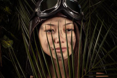 Portrait of beautiful girl with face soiled with a tropical leaf Royalty Free Stock Photos