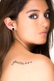 Portrait of beautiful girl with faith tatoo on her Stock Photography