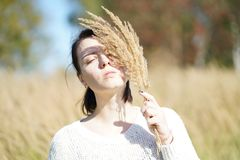 Portrait of a beautiful girl in a field. With dry grass Stock Photos