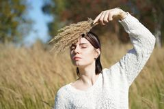 Portrait of a beautiful girl in a field Royalty Free Stock Photo