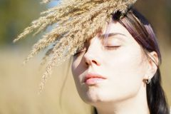 Portrait of a beautiful girl in a field Royalty Free Stock Photography