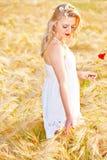 Portrait of beautiful girl in field Stock Photo