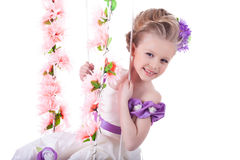 Portrait of beautiful girl on floral swing royalty free stock image