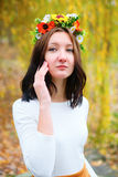 Portrait beautiful girl with flower wreath on her head Stock Image