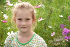 Portrait of a beautiful girl in the flowers Royalty Free Stock Images
