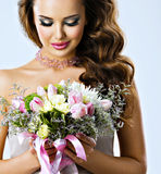 Portrait of beautiful girl with flowers in hands Royalty Free Stock Photo