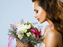 Portrait of beautiful girl with flowers in hands Stock Photography