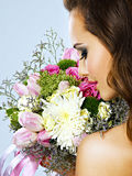 Portrait of beautiful girl with flowers in hands Royalty Free Stock Photos
