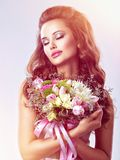 Portrait of beautiful girl with flowers in hands royalty free stock images