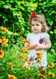 Portrait of a beautiful girl among the flowers Stock Photography