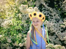 Portrait of beautiful girl with flowers of sunflowers on his head. Royalty Free Stock Image