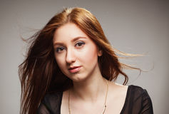 Portrait of beautiful girl with fluttering hairon  Royalty Free Stock Images