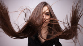 Portrait of girl with flying hair Royalty Free Stock Image