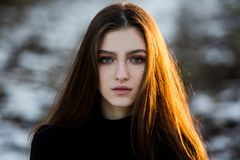 Portrait of a beautiful girl with flying hair in the wind. Young sad woman. Portrait of lonely woman stock images