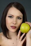 Portrait of a beautiful girl with fruit Royalty Free Stock Photos