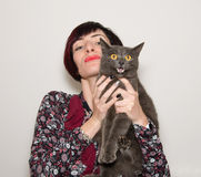 Portrait of beautiful girl with funny chartreux cat stock photos