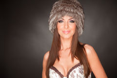 Portrait of beautiful girl in furry hat Royalty Free Stock Photo