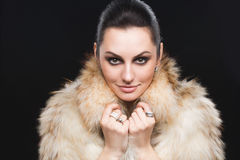 Portrait of beautiful girl in furs, rings Stock Image