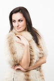 Portrait of beautiful girl in furs, rings Stock Photography