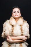 Portrait of beautiful girl in furs, rings Royalty Free Stock Photography