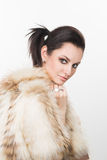 Portrait of beautiful girl in furs, rings Royalty Free Stock Image