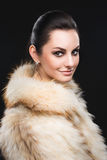 Portrait of beautiful girl in furs, rings Stock Photo