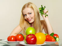 Portrait of beautiful girl with garden greens Stock Image