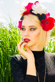 Portrait beautiful girl. Beautiful girl with garland of wild flowers on her head Royalty Free Stock Photo