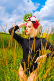 Portrait beautiful girl. Beautiful girl with garland of wild flowers on her head Royalty Free Stock Images