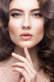 Portrait of beautiful girl with a gentle makeup, curls and crystals on the body. beauty face. Royalty Free Stock Photos