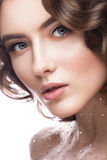 Portrait of beautiful girl with a gentle makeup, curls and crystals on the body. beauty face. Stock Photo