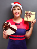 Portrait of a beautiful girl with gift boxes Stock Images