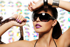 Portrait of beautiful girl with glamour sunglasses. Close-up portrait of beautiful girl with glamour sunglasses on her face Royalty Free Stock Image