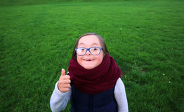 Portrait of beautiful girl with glasses in park Stock Image
