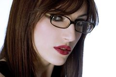 Portrait of a beautiful girl with glasses on white. Background Royalty Free Stock Image
