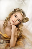Portrait of a beautiful girl in a gold. Dress royalty free stock photos