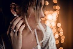 Portrait of beautiful girl on golden bokeh lights background Stock Images