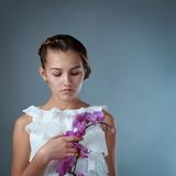 Portrait of beautiful girl on gray background Royalty Free Stock Photography