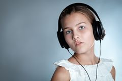 Portrait of beautiful girl on gray background Stock Image