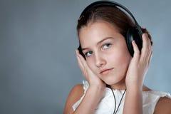 Portrait of beautiful girl on gray background Stock Photo